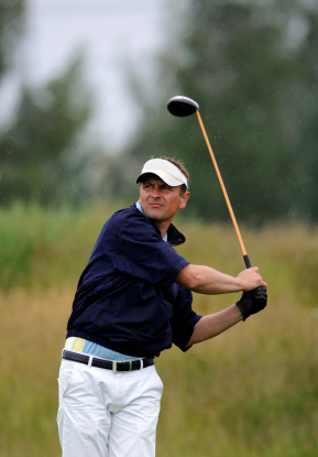 a golfer holding his finish after tee shot